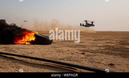 U.S. Marine Corps MV-22 Ospreys, piloted by Marines with Medium Tilt Rotor Squadron 364, attached to Special Purpose Marine Air-Ground Task Force Crisis Response-Central Command, lands during a Tactical Recovery of Aircraft and Personnel Exercise in Camp Buehring Kuwait, Aug. 7, 2019. A TRAP mission is carried out by a quick reaction force in the event the location of allied personal, equipment, or aircraft is compromised. The SPMAGTF-CR-CC is a quick reaction force, prepared to deploy a variety of capabilities across the region. (U.S. Marine Corps photo by Lance Cpl. Mackenzie Binion) - Stock Photo