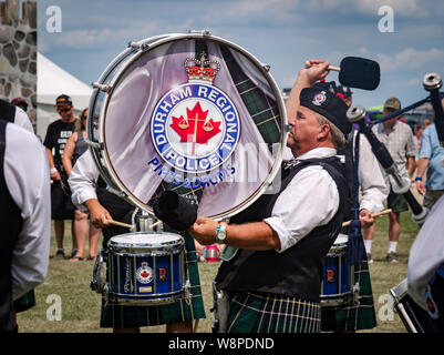 Fergus, Ontario, Canada - 08 11 2018: Drummer of the Durham Regional Police Pipes and Drums band participating in the Pipe Band contest held by Pipers - Stock Photo