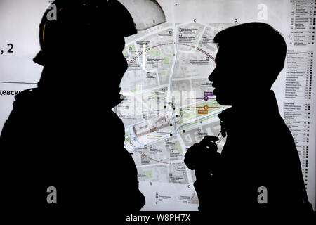 Moscow, Russia. 10th, August, 2019 A police officer speaks with a young protester in underground station 'Kitay-Gorod' during an unauthorized rally in support of detainees in protests and rejected Moscow City Duma candidates in central Moscow, Russia - Stock Photo