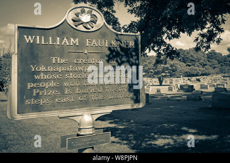 A historic marker noting the nearby burial site of Nobel Prize Laureate, William Faulkner, in his hometown of Oxford, MS, in sepia tone - Stock Photo