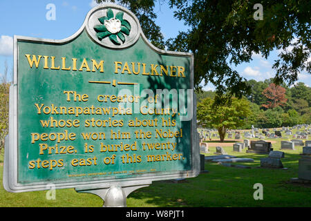A historic marker noting the nearby burial site of Nobel Prize Laureate, William Faulkner, in his hometown of Oxford, MS - Stock Photo