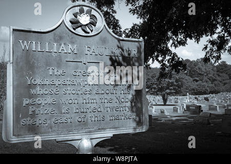 A historic marker noting the nearby burial site of Nobel Prize Laureate, William Faulkner, in his hometown of Oxford, MS, in selenium tone - Stock Photo