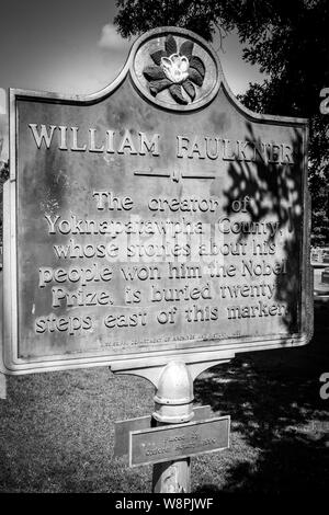 A historic marker noting the nearby burial site of Nobel Prize Laureate, William Faulkner, in his hometown of Oxford, MS, black and white - Stock Photo