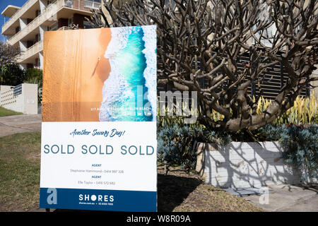 Real estate agent Shores marketing board shows sydney apartment has been sold,Avalon Beach Australia - Stock Photo