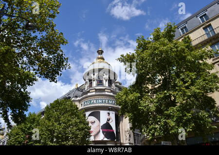 Paris/France - August 19, 2014: Beautiful women photos on the facade of the famous Au Printemps department store for beauty biggest in the world. - Stock Photo