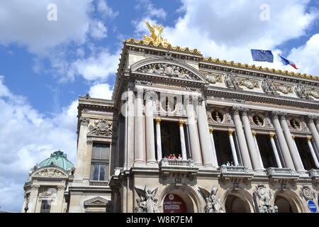 Paris/France - August 19, 2014: Facade of the Opera de Paris and National Academy of music with golden statues on the roof in a sunny weather under th - Stock Photo