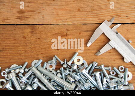 Bolts and nuts on a workbench - Stock Photo