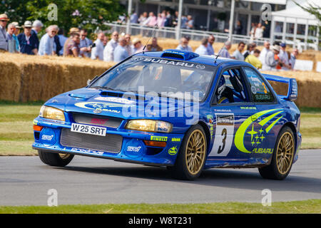 2000 Subaru Impreza WRX STi World Rally Championship racer with driver Christopher Wilson at the 2019 Goodwood Festival of Speed, Sussex, UK. - Stock Photo