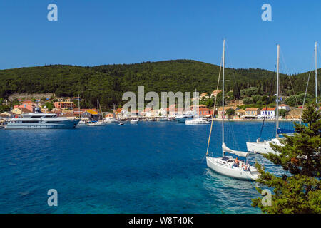 Yachts moored at Fiskardo Village, Cephalonia, Greece - Stock Photo