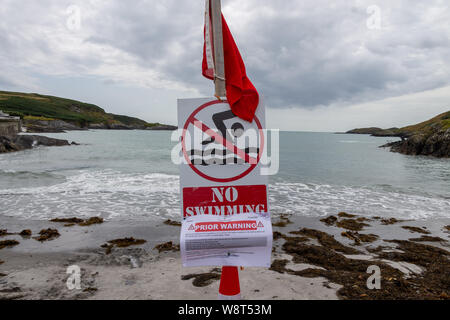 """Tragumna, West Cork, Ireland. 10th August 2019. Tragumna Beach a popular holiday beach along with 5 other beaches in County Cork had """"No Swim"""" signs erected over the weekend. The recent heavy rain has been blamed for the notices warning of the possible risk of high bacteria levels. The waters will be retested on Monday 12th August and results made public on 14th August. Credit aphperspective/ Alamy Live News Stock Photo"""