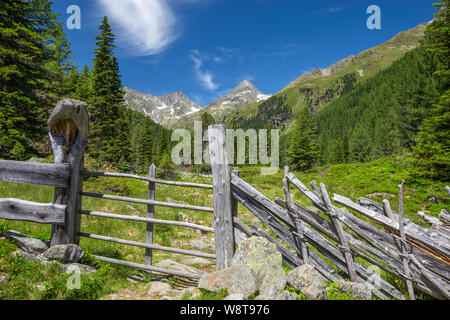 Wooden fence. Debanttal. Schobergruppe massif. Austria. - Stock Photo