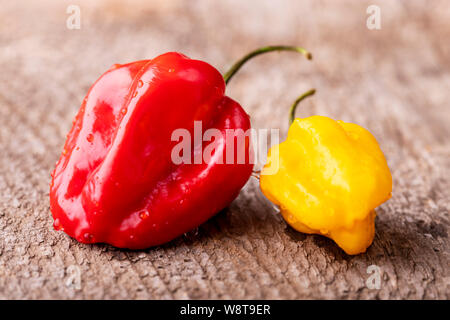 red and yellow habanero chili on wood - Stock Photo