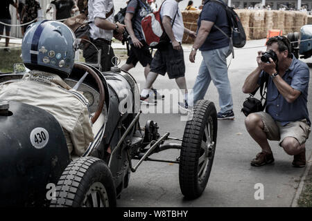 1931 Bugatti Type 35C waiting to go out on the hillclimb at the 2019 Goodwood Festival of Speed, Sussex, UK. Passing spectators and photographer. - Stock Photo