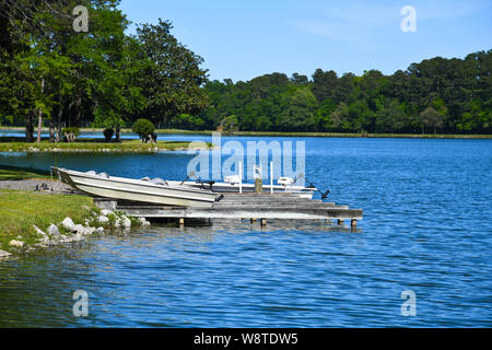 Fishing Boats at the Boat Dock on a Recreational Fishing Lake - Stock Photo
