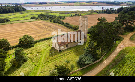 An aerial photo of Ramsholt church. A beautiful traditional church with a round tower located in the beautiful Suffolk countryside close to the River - Stock Photo