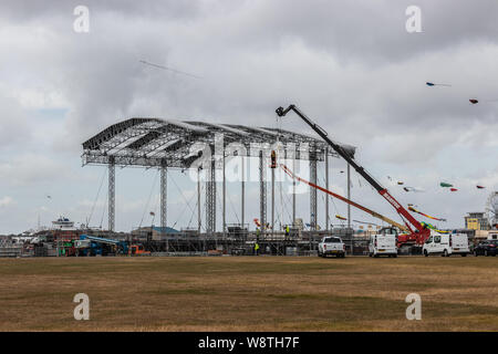 The main stage for Portsmouth's Victorious festival being built at Southsea common - Stock Photo