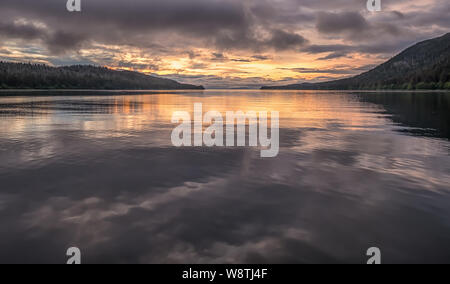 Looking North in Calm Water at Sunset at Cleveland Passage Between Whitney Island  and the Fanshaw Range on Mainland North America, Alaska, USA - Stock Photo