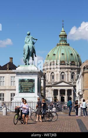 Copenhagen Denmark travel - people cycling in the Amalienborg Palace and Frederiks Church, Copenhagen city centre, Denmark Scandinavia Europe - Stock Photo