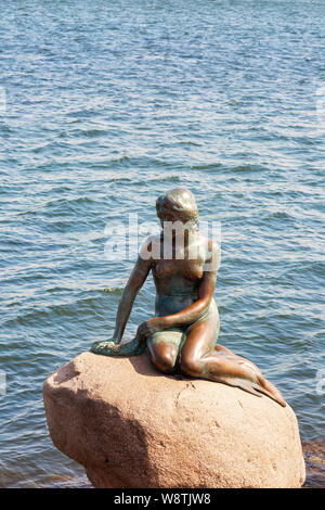 The famous Little Mermaid statue Copenhagen, a bronze statue by  Edvard Eriksen, at the waterside since 1913, Copenhagen Denmark Europe - Stock Photo