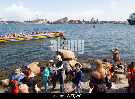 Copenhagen tourists - crowds of people looking at the famous statue of the Little Mermaid, Copenhagen Denmark Scandinavia Europe - Stock Photo