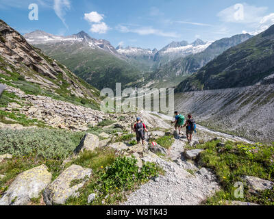 Hikers enjoy the rugged mountain landscape near the Berliner Hut in the Zillertal Alps in the Austrian Tirol - Stock Photo