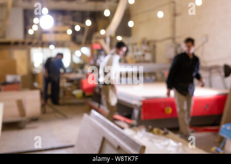 factory, Small-Sized Companies, business and manufacturing concept - defocused background with factory and workers - Stock Photo