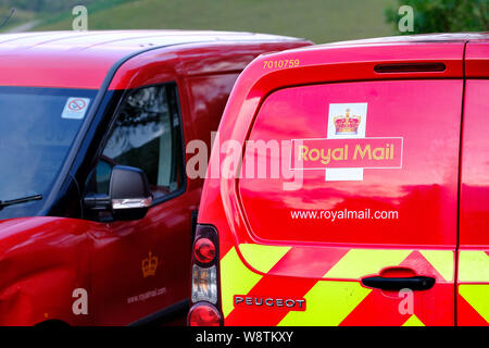 Parked Royal Mail post vans at Strathcarron Post Office, Highlands of Scotland - Stock Photo