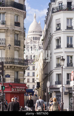 Paris Montmartre street -  street scene at Place d'Anvers with a view of the Sacre Coeur basilica in Montmartre, Paris, France, Europe. - Stock Photo