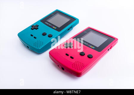 Nintendo Game Boy Color in two colours - Stock Photo