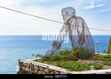 Pizzo, Italy - September 10, 2016: Iron net statue by Eduardo Tresoldi called The Old Man and the Sea located in Pizzo in southern Italy - Stock Photo