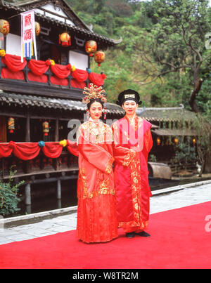 Wedding couple in national costume, Sung Dynasty Village, Kowloon, Hong Kong, People's Republic of China - Stock Photo