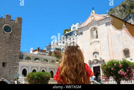 Summer holiday in Italy. Portrait of young woman with red dress in Taormina village, Sicily, Italy. - Stock Photo