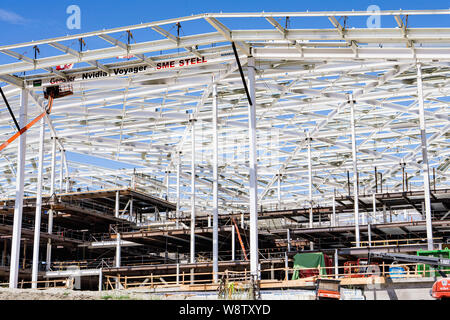 August 9, 2019 Santa Clara / CA / USA - The new, massive Nvidia Voyager building under construction at the company's corporate campus in Silicon Valle - Stock Photo