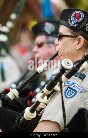 Closeup of female playing the bagpipes at the start of the Blairsville Scottish Highland Games at Meeks Park on June 9, 2018 in Blairsville, GA. - Stock Photo