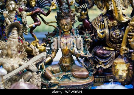 Hindu gods (Shiva, Vishnu, Parvati, Lakshmi, Sarasvati) Hinduism sculptures in a market for sale to tourists. - Stock Photo