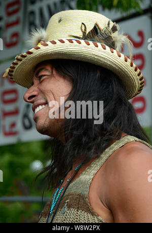 A handsome Native American man wears a artist-made top hat in Santa Fe, New Mexico - Stock Photo