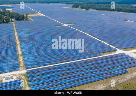 Aerial view of large solar panel farm in Northern Florida providing clean energy.