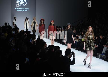 --FILE--Foreign and Chinese models display new creations at the Hong Kong?Fashion collection Fashion show during the China Fashion Week Fall/Winter 20 - Stock Photo