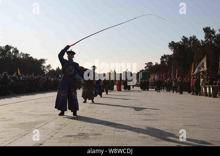 Entertainers dressed in costumes of the Qing Dynasty (AD 1644 - 1911) perform during a rehearsal of the ancient royal heaven worship ceremony for upco - Stock Photo
