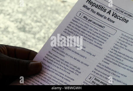 Orlando, United States. 11th Aug, 2019. A man reads an information sheet at a hepatitis A vaccination event sponsored by the Orange County, Florida Health Department in response to the hepatitis A outbreak in the State of Florida and the August 1, 2019 declaration of a public health emergency in the state. As of July 1, 2019, twenty-seven states have experienced outbreaks of the disease, with Florida having 2,586 reported cases, the third highest in the United States, resulting in 31 deaths. Credit: SOPA Images Limited/Alamy Live News - Stock Photo