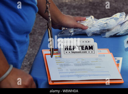Orlando, United States. 11th Aug, 2019. A clipboard with patient consent forms is seen at a hepatitis A vaccination event sponsored by the Orange County, Florida Health Department in response to the hepatitis A outbreak in the State of Florida and the August 1, 2019 declaration of a public health emergency in the state. As of July 1, 2019, twenty-seven states have experienced outbreaks of the disease, with Florida having 2,586 reported cases, the third highest in the United States, resulting in 31 deaths. Credit: SOPA Images Limited/Alamy Live News - Stock Photo