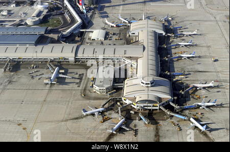 --FILE--Aerial view of jet planes at the Terminal 2 of the Beijing Capital International Airport in Beijing, China, 17 January 2011.   Beijing plans t - Stock Photo