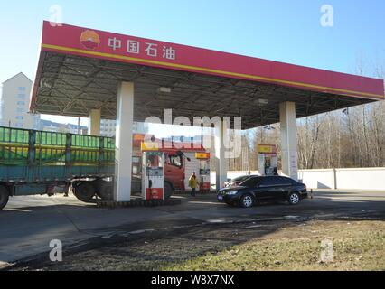 --FILE--Vehicles are being refueled at a gas station of CNPC (China National Petroleum Corporation) in Heihe city, northeast Chinas Heilongjiang provi - Stock Photo