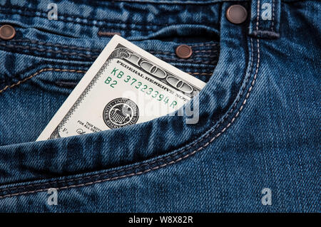 Dollars cash bill in a pocket of blue jeans - Stock Photo