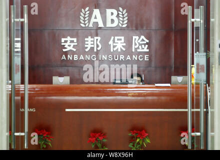 --FILE--A Chinese employee works at the front desk at a branch of Anbang Insurance in Shanghai, China, 20 December 2010.   Anbang Insurance Group Co, - Stock Photo