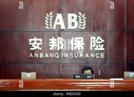 --FILE--A Chinese employee works at the front desk at a branch of Anbang Insurance in Shanghai, China, 20 December 2010.   Dutch insurer Delta Lloyd N - Stock Photo