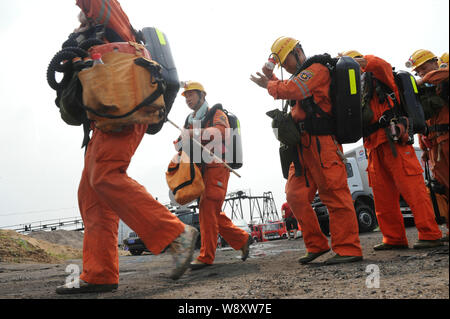 --FILE--Chinese rescuers leave the Dongfang Coal Mine after a rescue mission at the Dongfang Coal Mine after an explosion, which killed six people, in - Stock Photo