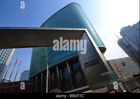 --FILE--View of the headquarters building of CNOOC (China National Offshore Oil Corporation) in Beijing, China, 26 February 2013.   China National Off - Stock Photo