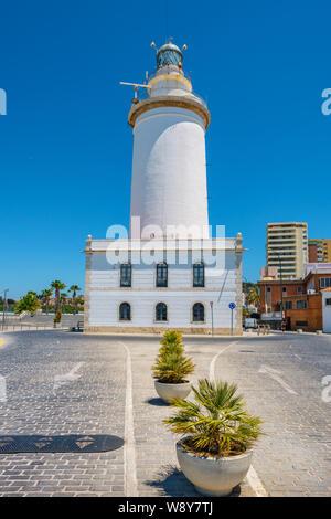 View at white lighthouse building (La Farola). Malaga, Costa del Sol, Andalusia, Spain - Stock Photo