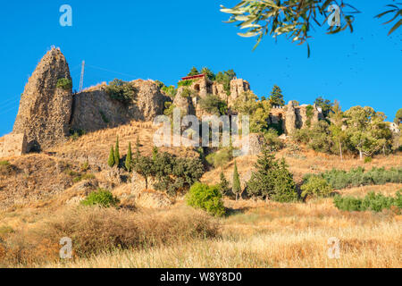 Natural landscape with cliffs and remains of the Arab walls. Ronda, Andalusia, Spain - Stock Photo
